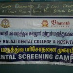 Photograph  showing the banner of Sri Balaji Dental College & Hospital conducting the Dental screening camp on 3rd October