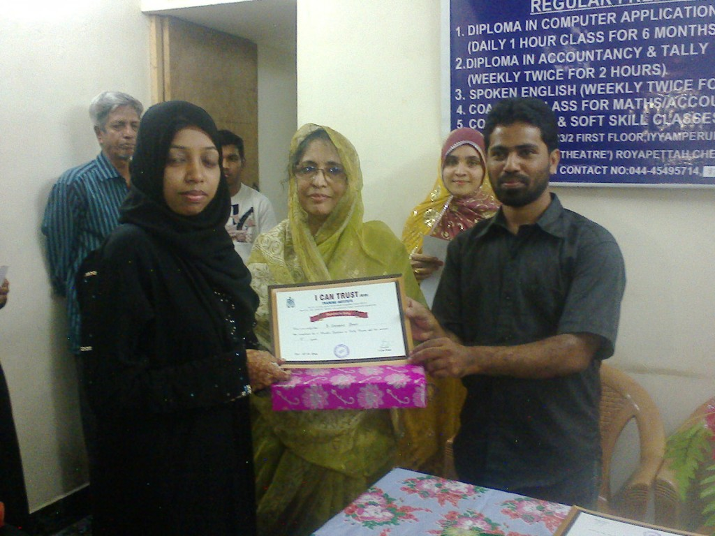 B. Shenaz Begum receiving the Second Prize Certificate